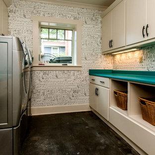 На фото: прачечная в стиле современная классика с бетонным полом и бирюзовой столешницей с