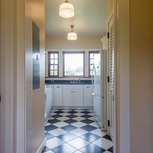 Example of a mid-sized classic u-shaped ceramic tile and white floor dedicated laundry room design in Hawaii with shaker cabinets, white cabinets and beige walls
