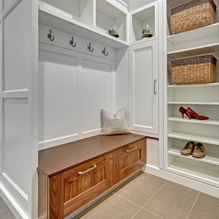 Inspiration for a small transitional galley utility room in Sacramento with recessed-panel cabinets, white cabinets, quartz benchtops, white splashback, porcelain splashback, grey walls and porcelain floors.