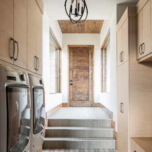 Dedicated laundry room - rustic galley dedicated laundry room idea in Salt Lake City with flat-panel cabinets, light wood cabinets, white walls and a side-by-side washer/dryer