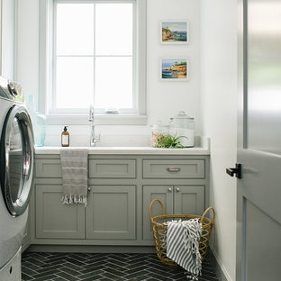 Dedicated laundry room - beach style l-shaped gray floor dedicated laundry room idea in Los Angeles with gray cabinets, white walls, white countertops and beaded inset cabinets