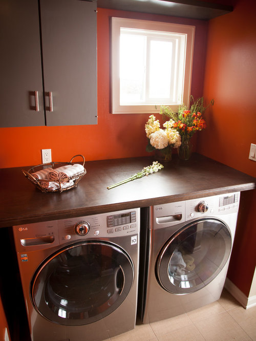 Nice Laundry Room Counters Part - 13: Transitional Beige Floor Laundry Room Idea In Los Angeles With Brown  Cabinets