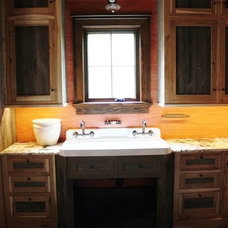Rustic Laundry Room by Gregory Paolini Design LLC