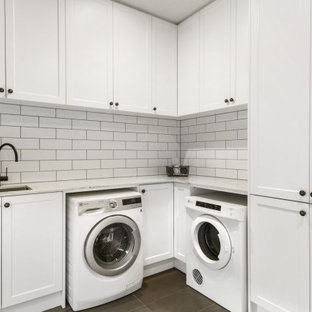 Photo of a transitional laundry room in Other.