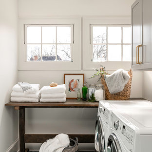 Dedicated laundry room - mid-sized transitional single-wall green floor dedicated laundry room idea in Atlanta with gray cabinets, white walls, a side-by-side washer/dryer and shaker cabinets