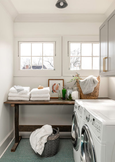 Transitional Laundry Room by JOMA Construction