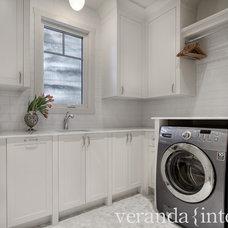 Transitional Laundry Room by Veranda Estate Homes & Interiors