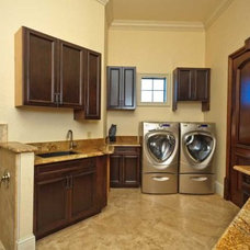 Mediterranean Laundry Room by MJS Inc. Custom Home Designs