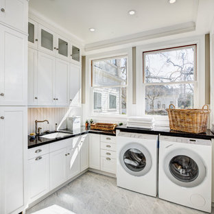 Inspiration for a huge timeless l-shaped marble floor and gray floor dedicated laundry room remodel in Sacramento with white cabinets, an undermount sink, shaker cabinets, quartz countertops, white walls and a side-by-side washer/dryer