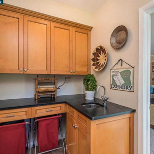 Photo of a classic utility room in San Francisco with a built-in sink, shaker cabinets, light wood cabinets, soapstone worktops and black worktops.