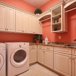 Esempio di una grande sala lavanderia chic con lavello sottopiano, ante con bugna sagomata, ante bianche, top in granito, pareti rosa, pavimento con piastrelle in ceramica e lavatrice e asciugatrice affiancate