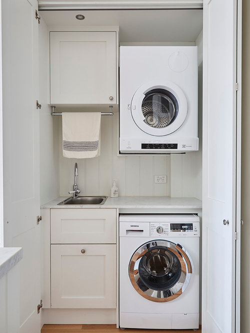 75 laundry cupboard design ideas remodeling pictures that will inspiration for a mid sized country laundry cupboard in melbourne with shaker cabinets white solutioingenieria Images