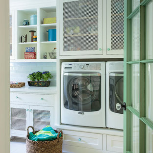 Example of a large beach style single-wall porcelain tile and white floor dedicated laundry room design in Los Angeles with shaker cabinets, white cabinets, quartz countertops, a side-by-side washer/dryer and white countertops