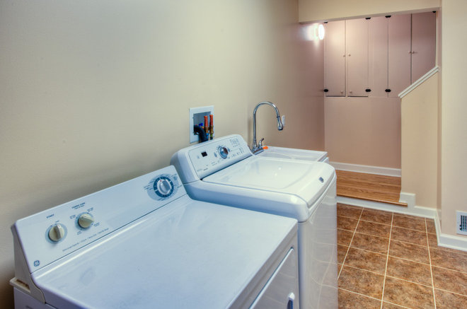 Transitional Laundry Room by HOUSEworks Design/Build General Contractor