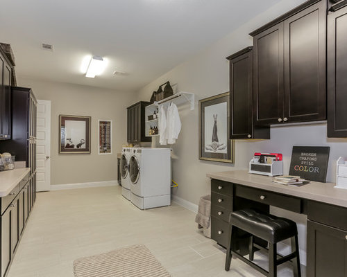 Huge Transitional U Shaped Laminate Floor And Beige Floor Utility Room  Photo In Houston With