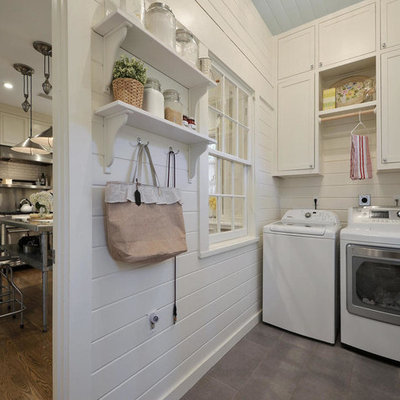 Farmhouse laundry room photo in Austin with shaker cabinets, white cabinets, white walls and a side-by-side washer/dryer