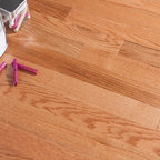 """Impressions Hardwood - Berkshire Golden - Our versatile Berkshire Series is offered in 1/2"""" thick engineered hardwood for the look of solid flooring. Available in a 3 1/4"""" width with a micro bevel edge. Berkshire may be installed above, below or on grade, by floating, glue down, staple, or nailing. Berkshire features a thick sawn face wear layer and is available in random lengths up to 48 inches."""