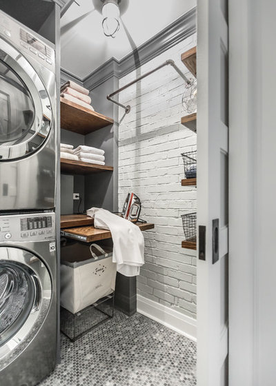 Industrial Laundry Room by Designstorms LLC