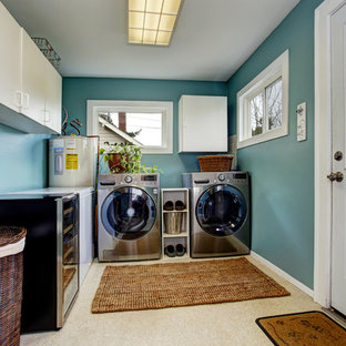 Dedicated laundry room - mid-sized traditional l-shaped laminate floor and beige floor dedicated laundry room idea in Manchester with flat-panel cabinets, white cabinets and blue walls