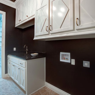 Photo of a large traditional galley separated utility room in Oklahoma City with shaker cabinets, white cabinets, composite countertops, black walls, limestone flooring and a side by side washer and dryer.