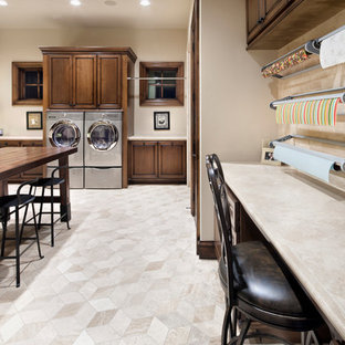 Example of a huge tuscan u-shaped utility room design in Houston with raised-panel cabinets