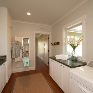 Design ideas for an arts and crafts dedicated laundry room in Hawaii with white cabinets, granite benchtops, bamboo floors and a side-by-side washer and dryer.