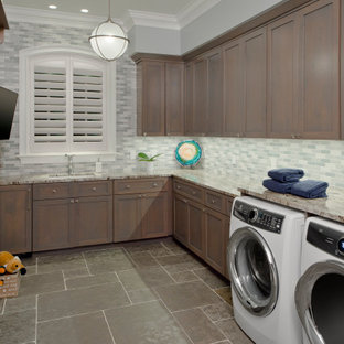French country l-shaped gray floor dedicated laundry room photo in Baltimore with a single-bowl sink, shaker cabinets, brown cabinets, gray walls, a side-by-side washer/dryer and multicolored countertops