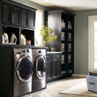 Design ideas for a large transitional l-shaped utility room in Other with an integrated sink, shaker cabinets, grey cabinets, grey walls, a side-by-side washer and dryer and grey benchtop.
