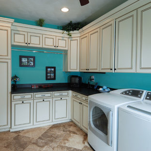 Inspiration for a traditional utility room in Other with beige cabinets, blue walls, beige floors and black worktops.
