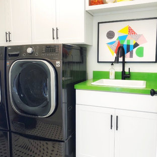 Dedicated laundry room - country multicolored floor dedicated laundry room idea in Other with a drop-in sink, shaker cabinets, white cabinets, white walls, a side-by-side washer/dryer and green countertops