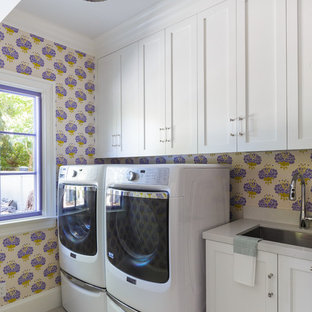 Inspiration for a timeless gray floor dedicated laundry room remodel in San Francisco with an undermount sink, shaker cabinets, white cabinets, multicolored walls, a side-by-side washer/dryer, gray countertops and marble countertops