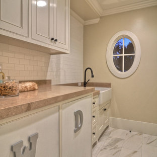 Inspiration for a transitional laundry room remodel in Orange County