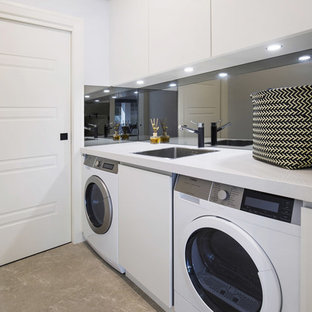 Small minimalist single-wall limestone floor and beige floor dedicated laundry room photo in Sydney with a single-bowl sink, flat-panel cabinets, white cabinets, quartz countertops and white walls