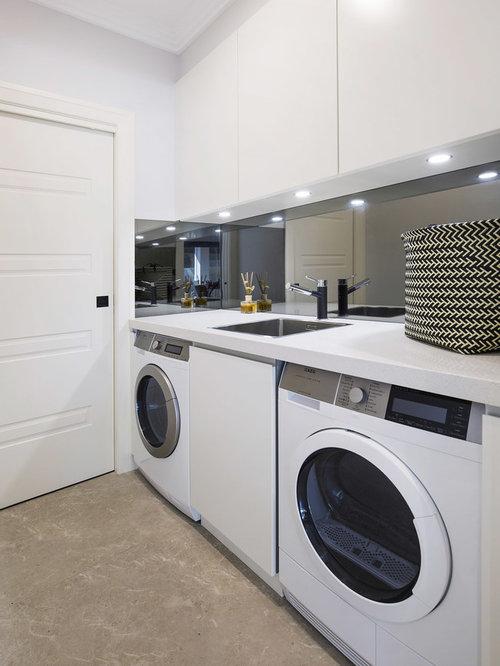buanderie moderne avec un sol en calcaire photos et. Black Bedroom Furniture Sets. Home Design Ideas