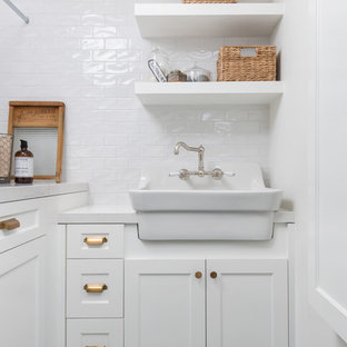 Inspiration for a small country l-shaped separated utility room in San Francisco with a belfast sink, beaded cabinets, white cabinets, engineered stone countertops, white walls, ceramic flooring, a side by side washer and dryer, blue floors and white worktops.