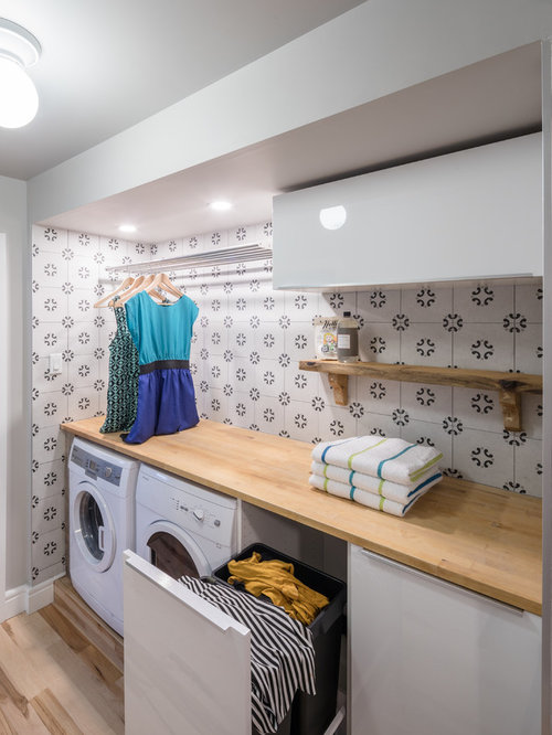 example of a small trendy single wall light wood floor dedicated laundry room design in - Laundry Design Ideas