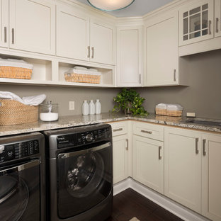 Small transitional l-shaped dark wood floor and black floor dedicated laundry room photo in Detroit with white cabinets, gray walls, an undermount sink, shaker cabinets, quartz countertops, a side-by-side washer/dryer and beige countertops