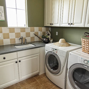 Tuscan l-shaped porcelain floor and beige floor dedicated laundry room photo in Denver with an undermount sink, raised-panel cabinets, white cabinets, solid surface countertops and green walls