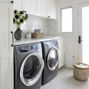 Inspiration for a small traditional single-wall separated utility room in San Francisco with a built-in sink, shaker cabinets, white cabinets, marble worktops, white walls, ceramic flooring, a side by side washer and dryer, beige floors and white worktops.