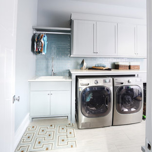 Example of a large classic galley porcelain tile dedicated laundry room design in Other with shaker cabinets, white cabinets, gray walls, a side-by-side washer/dryer and quartz countertops