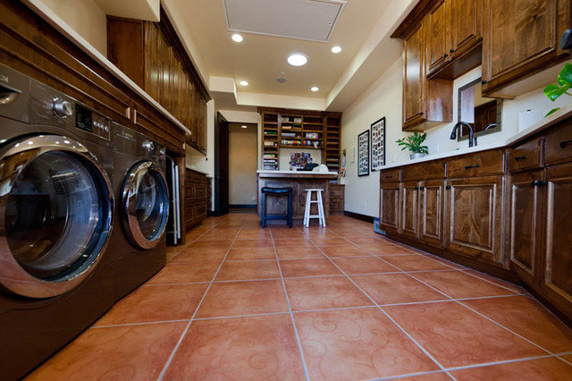 Mediterranean Laundry Room by Isaman design, Inc.