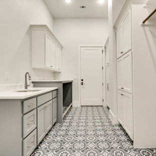 This is an example of a large mediterranean galley separated utility room in Dallas with shaker cabinets.