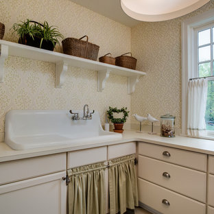 Inspiration for a timeless l-shaped gray floor dedicated laundry room remodel with a drop-in sink, recessed-panel cabinets, beige cabinets, beige walls and beige countertops