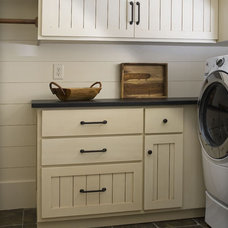 Rustic Laundry Room by The Berry Group