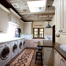 Rustic Laundry Room by Greenwood Homes