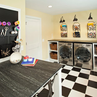 Laundry room - transitional multicolored floor laundry room idea in Minneapolis with yellow walls