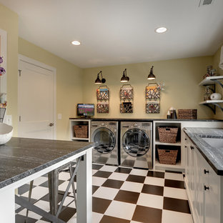 Elegant multicolored floor laundry room photo in Minneapolis with white cabinets, a side-by-side washer/dryer and gray countertops