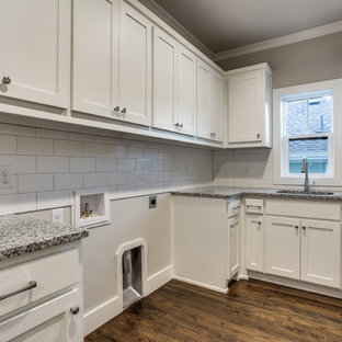 This is an example of a mid-sized country l-shaped utility room in Dallas with shaker cabinets, white cabinets, subway tile splashback, an undermount sink, granite benchtops, grey walls, dark hardwood floors and a side-by-side washer and dryer.