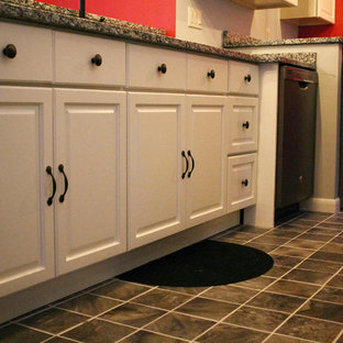 Design ideas for a large classic single-wall utility room in Miami with raised-panel cabinets, white cabinets, granite worktops, red walls, porcelain flooring, a side by side washer and dryer and brown floors.
