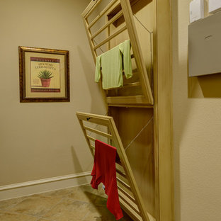 Mid-sized tuscan travertine floor dedicated laundry room photo in Dallas with beige walls